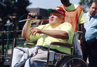 Man in Wheelchair Talking into Microphone