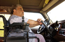 Man driving with assistive technology.