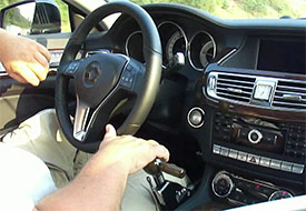 Photo of a driver using hand controls to operate his car.
