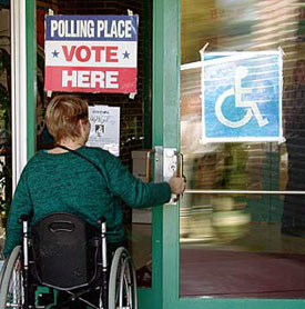 Photograph of a lady in a wheelchair entering an accessible polling place